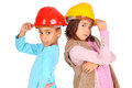 Constructors little girls with contruction helmets Royalty Free Stock Photos
