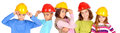 Constructors little kids with contruction helmets Stock Photo