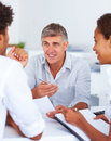 A consultant discussing with colleagues at work Royalty Free Stock Photo