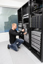 It consultant replace blade server in datacenter engineer or working with installation of a data rack shot Royalty Free Stock Photo