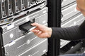 It consultant work with backup in datacenter engineer or working server racks shot data center Stock Images