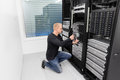 It consultant working in datacenter engineer or with installation of a blade server data rack shot Stock Photos