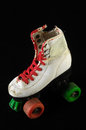 Consumed roller skate used vintage on a black background Stock Photography