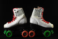 Consumed roller skate used vintage on a black background Royalty Free Stock Photo