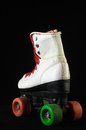 Consumed roller skate used vintage on a black background Royalty Free Stock Photos