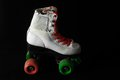 Consumed roller skate used vintage on a black background Stock Photo