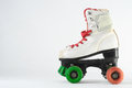 Consumed roller skate used vintage on a white background Stock Image