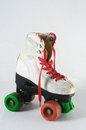 Consumed roller skate used vintage on a white background Royalty Free Stock Image