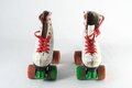 Consumed roller skate used vintage on a white background Stock Photo