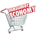 Consumer economy shopping cart buying goods customer orders words in a to symbolize our nation s trade of and services for money Royalty Free Stock Photos