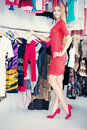 Consumerism fashionable girl shopping in a store Royalty Free Stock Images