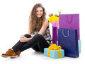 Consumerism portrait of a young woman with gifts and shopping Stock Photo
