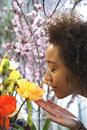 Consumerism woman smelling fresh flowers at a florist Stock Photos