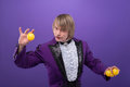 Consummate mastery of magician half length portrait fair haired enigmatic juggler wearing splendid violet jacket and white blouse Royalty Free Stock Photos