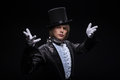 Consummate mastery of magician half length portrait fair haired matchless juggler wearing interesting black costume and white Royalty Free Stock Photo