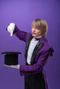 Consummate mastery of magician half length portrait fair haired matchless juggler wearing splendid violet costume and white shirt Royalty Free Stock Images