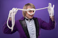 Consummate mastery of magician half length portrait fair haired matchless smiling juggler wearing splendid violet costume and Stock Photo