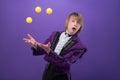 Consummate mastery of magician half length portrait funny surprised juggler wearing splendid violet jacket standing aside juggling Stock Images