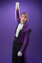 Consummate mastery of magician half length portrait very excited juggler wearing splendid violet jacket and white shirt wanted to Royalty Free Stock Image