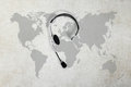 Contact global concept , top view headset and map Royalty Free Stock Photo
