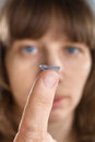 Contact lens on finger of woman (selective focus used) Royalty Free Stock Photo
