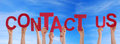 Contact Us in Front of the Sky Royalty Free Stock Photo