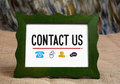 Contact Us with Icons of Phone and communication Royalty Free Stock Photo