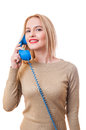 Contact us woman concept with a female talking on the phone and looking into the camera Royalty Free Stock Photos