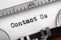Contact us written on typewriter an old concept for support service and assistance Royalty Free Stock Photos