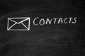 Contacts on the blackboard drawn envelope and written Royalty Free Stock Photo