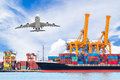 Container cargo freight ship with working crane loading bridge Royalty Free Stock Photo