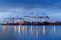 Container Cargo port freight ship with working crane bridge in s Royalty Free Stock Photo