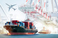 Container Cargo ship and Cargo plane with working crane bridge in shipyard background Royalty Free Stock Photo