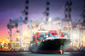 Container Cargo ship with ports crane bridge in harbor for logistic import export background Royalty Free Stock Photo