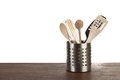 Container with kitchen utensils stainless steel on a wooden surface Stock Photos