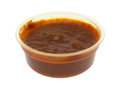 Container of marinara sauce on a white background Royalty Free Stock Photo