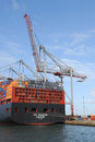 Container ship and crane southampton commercial port with being unloaded by cranes Royalty Free Stock Images
