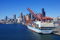 Container ship and dockyard cranes, Seattle waterfront Stock Images
