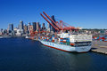Container ship and dockyard cranes seattle waterfront washington jun puget sound pacific northwest Stock Image