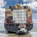 Container ship leaving the port of antwerp Stock Photos