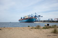 Container ship maersk mc kinney moller in gdansk poland august the largest on the world bulk carrier shipping line being unloaded Stock Photography