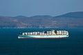 Container ship Sealand Michigan standing on the roads at anchor. Nakhodka Bay. East (Japan) Sea. 18.02.2014 Royalty Free Stock Photo