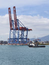 Container terminal with gantry cranes at malaga sea port vertical Stock Image