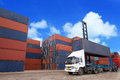 Containers at the docks with truck in cargo Royalty Free Stock Photos
