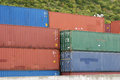 Containers many colorful shipping stacked in a row Royalty Free Stock Images