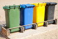 Containers in a row for separate garbage collection colorful plastic Royalty Free Stock Image