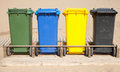 Containers in a row for separate garbage collection colorful plastic front view Royalty Free Stock Photo