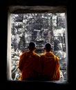 Contemplating monks, Angkor Wat, Siam Reap, Cambodia. Royalty Free Stock Photo