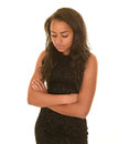 Contemplative teenage girl attractive young looking down with a serious thoughtful or expression Royalty Free Stock Photos