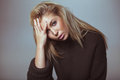 Contemplative woman in sweater pretty young looking serious Royalty Free Stock Photos